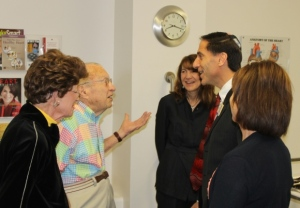Harold talks with Rose's Rabbi Jeffrey Kaye, who stopped by to say congratulations.